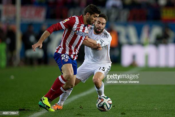 Emiliano Insua of Atletico de Madrid competes for the ball with Daniel Carvajal of Real Madrid CF during the Copa del Rey semifinal second leg match...