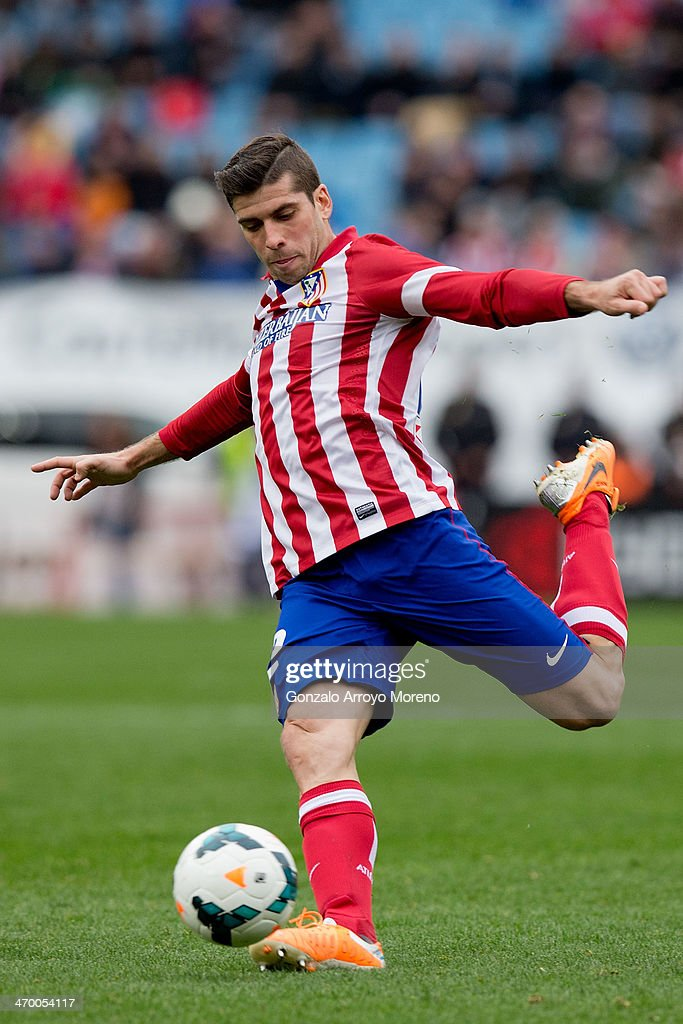 Emiliano Insua of Atletico de Madrid controls the ball during the La Liga match between Club Atletico de Madrid and Real Valladolid CF at Vicente Calderon Stadium on February 15, 2014 in Madrid, Spain.
