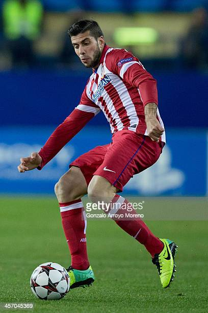 Emiliano Insua of Atletico de Madrid controls the ball during the UEFA Champions League Group G match at Vicente Calderon Stadium on December 11 2013...