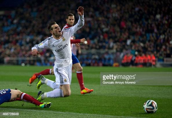Emiliano Insua of Atletico de Madrid fouls Gareth Bale of Real Madrid CF in the penalty area during the Copa del Rey semifinal second leg match...