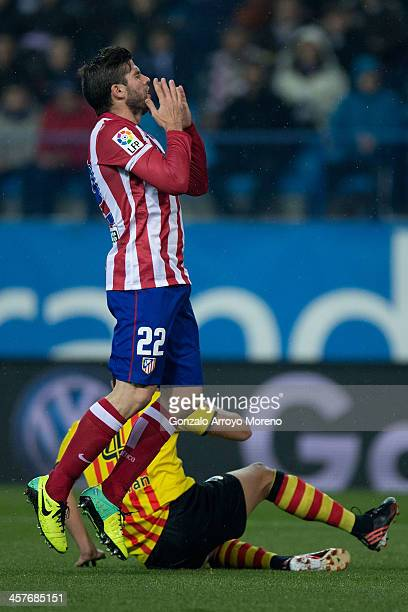 Emiliano Insua of Atletico de Madrid reacts as he fails to score during the Copa del Rey Round of 32 second leg match between Club Atletico de Madrid...