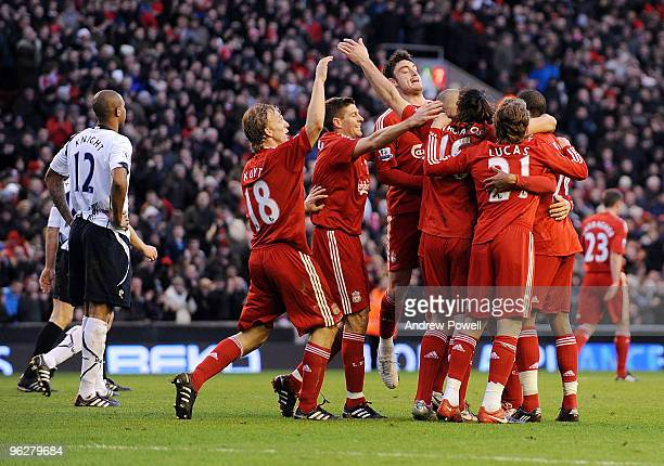 Emiliano Insua of Liverpool celebrates after scoring the second during the Barclays Premier League match between Liverpool and Bolton Wanderers at...
