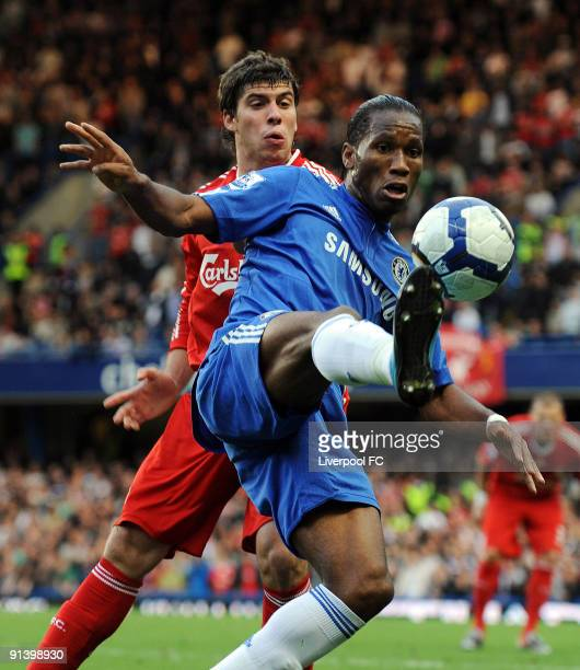 Emiliano Insua of Liverpool competes with Didier Drogba of Chelsea during the Barclays Premier League match between Chelsea and Liverpool at Stamford...