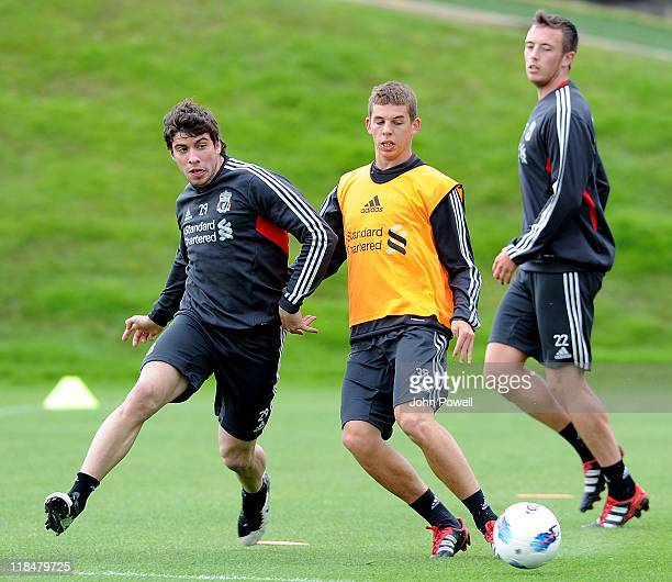 Emiliano Insua of Liverpool competes with John Flanagan of Liverpool in action during a Liverpool Training Session at Melwood training ground on July...