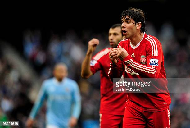 Emiliano Insua of Liverpool gestures to the linesman during the Barclays Premier League match between Manchester City and Liverpool at City of...