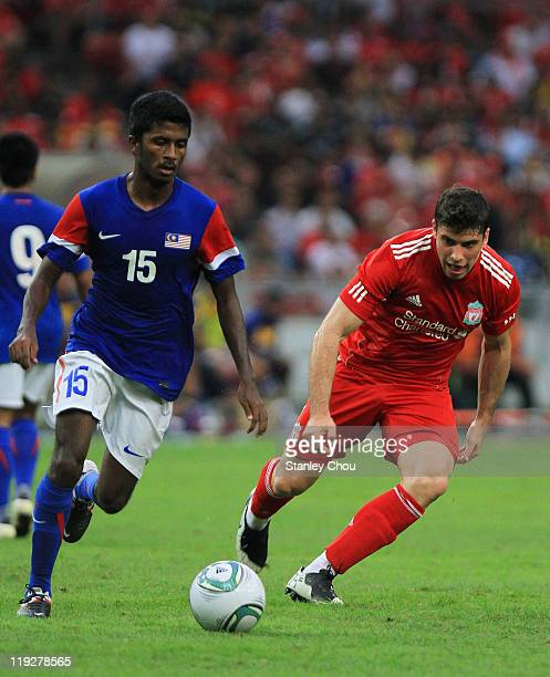 Emiliano Insua of Liverpool in action against K Gurusamy of Malaysia during the preseason friendly match between Malaysia and Liverpool at the Bukit...