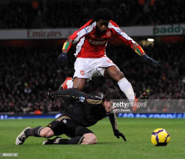 Emiliano Insua of Liverpool is brought down by Alex Song of Arsenal during the Barclays Premier League match between Arsenal and Liverpool at...