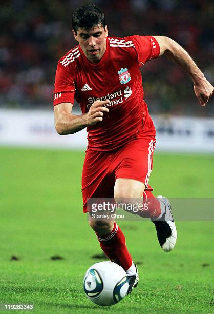 Emiliano Insua of Liverpool runs with the ball during the preseason friendly match between Malaysia and Liverpool at the Bukit Jalil National Stadium...