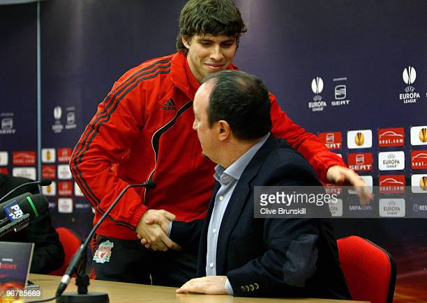 Emiliano Insua of Liverpool shakes hands with his manager Rafael Benitez during a press conference prior to the UEFA Europa League round of 32...