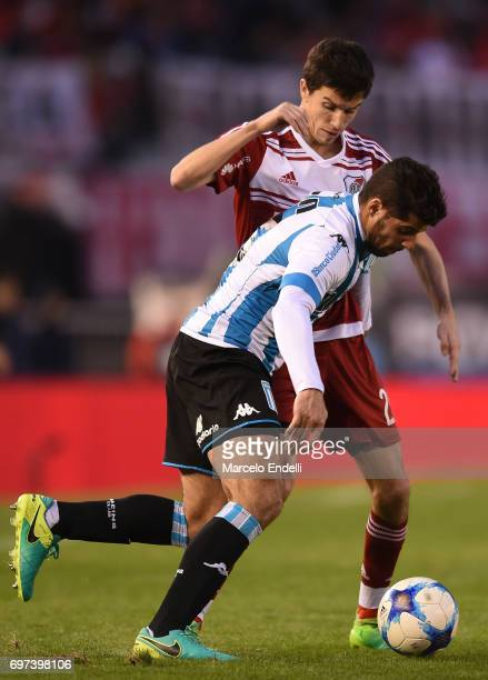 Emiliano Insua of Racing Club fights for the ball with Ignacio Fernandez of River Plate during a match between River Plate and Racing Club as part of...