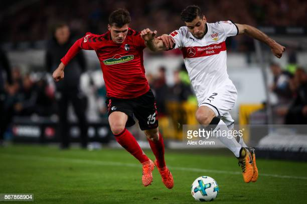 Emiliano Insua of Stuttgart and Pascal Stenzel of Freiburg battle for the ball during the Bundesliga match between VfB Stuttgart and SportClub...