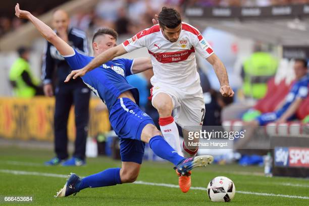 Emiliano Insua of Stuttgart is challenged by Fabian Reese of Karlsruhe during the Second Bundesliga match between VfB Stuttgart and Karlsruher SC at...