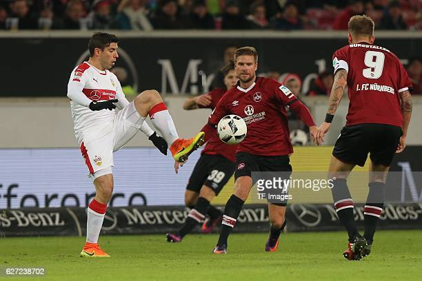 Emiliano Insua of Suttgart and Hanno Behrens of Nuerenberg battle for the ball during the second Bundesliga match between VfB Stuttgart and 1 FC...