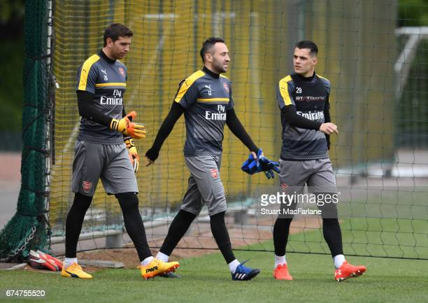 Emiliano Martinez David Ospina and Granit Xhaka of Arsenal before a training session at London Colney on April 29 2017 in St Albans England