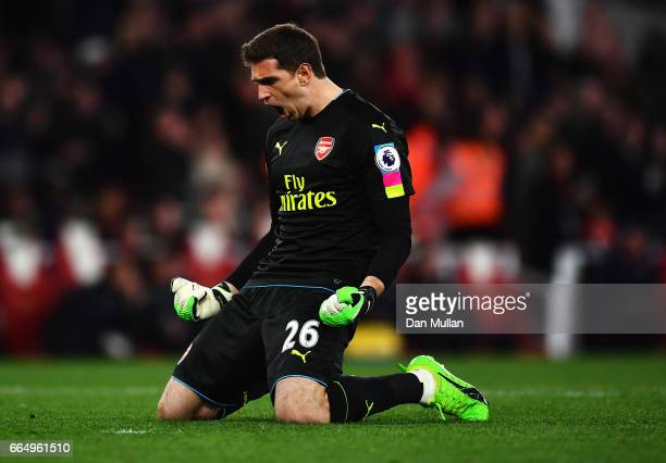 Emiliano Martinez of Arsenal celebrates his sides first goal during the Premier League match between Arsenal and West Ham United at the Emirates...