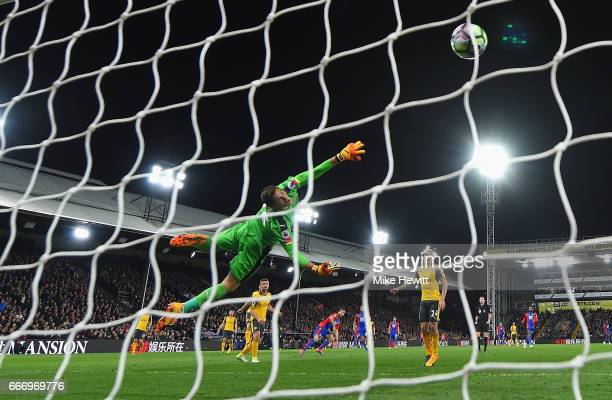 Emiliano Martinez of Arsenal fails to stop Yohan Cabaye of Crystal Palace from scoring their second goal during the Premier League match between...