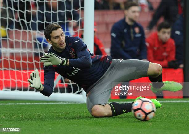 Emiliano Martinez of Arsenal warms up before the match between Arsenal and Lincoln City at Emirates Stadium on March 11 2017 in London England