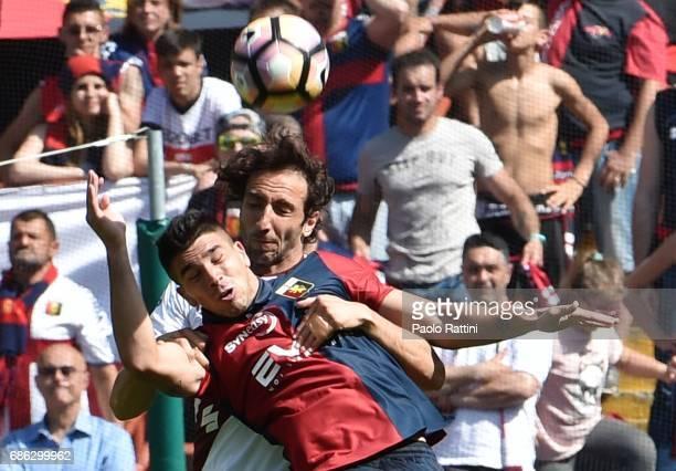 Emiliano Moretti of FC Torino and Giovanni Simeone of Genoa CFC during the Serie A match between Genoa CFC and FC Torino at Stadio Luigi Ferraris on...