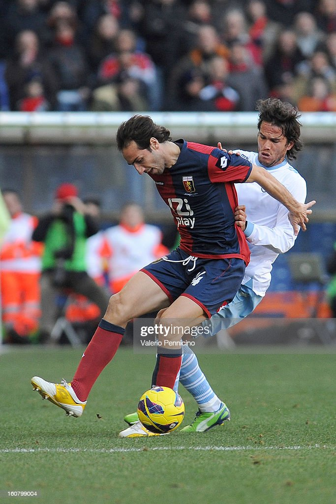 <a gi-track='captionPersonalityLinkClicked' href=/galleries/search?phrase=Emiliano+Moretti&family=editorial&specificpeople=653861 ng-click='$event.stopPropagation()'>Emiliano Moretti</a> (L) of Genoa CFC is challenged by <a gi-track='captionPersonalityLinkClicked' href=/galleries/search?phrase=Alvaro+Gonzalez+-+Fu%C3%9Fballspieler&family=editorial&specificpeople=2261829 ng-click='$event.stopPropagation()'>Alvaro Gonzalez</a> of S.S. Lazio during the Serie A match between Genoa CFC and SS Lazio at Stadio Luigi Ferraris on February 3, 2013 in Genoa, Italy.