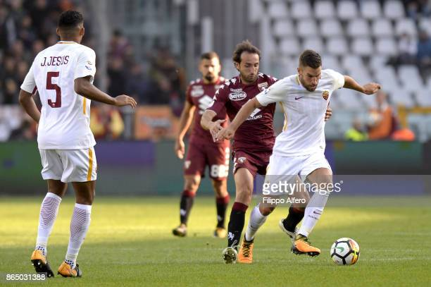 Emiliano Moretti of Torino and Kevin Strootman of AS Roma compete for the ball during the Serie A match between Torino FC and AS Roma at Stadio...