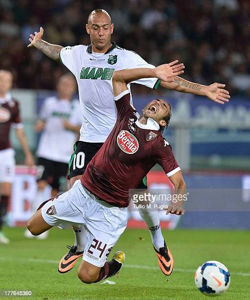 Emiliano Moretti of Torino and Simone Zaza of Sassuolo compete for the ball during the Serie A match between Torino FC and US Sassuolo Calcio at...