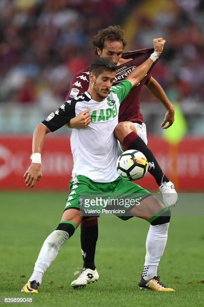 Emiliano Moretti of Torino FC competes with Diego Falcinelli of US Sassuolo during the Serie A match between Torino FC and US Sassuolo FC at Stadio...