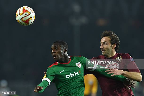 Emiliano Moretti of Torino FC competes with Inaki Williams of Athletic Club during the UEFA Europa League Round of 32 match between Torino FC and...