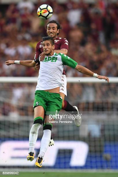 Emiliano Moretti of Torino FC goes up with Diego Falcinelli of US Sassuolo during the Serie A match between Torino FC and US Sassuolo FC at Stadio...