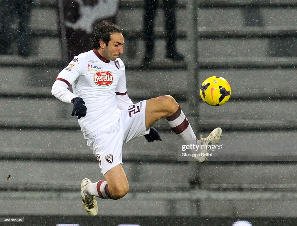 <a gi-track='captionPersonalityLinkClicked' href=/galleries/search?phrase=Emiliano+Moretti&family=editorial&specificpeople=653861 ng-click='$event.stopPropagation()'>Emiliano Moretti</a> of Torino in action during the Serie A match between US Sassuolo Calcio and Torino FC on January 19, 2014 in Sassuolo, Italy.
