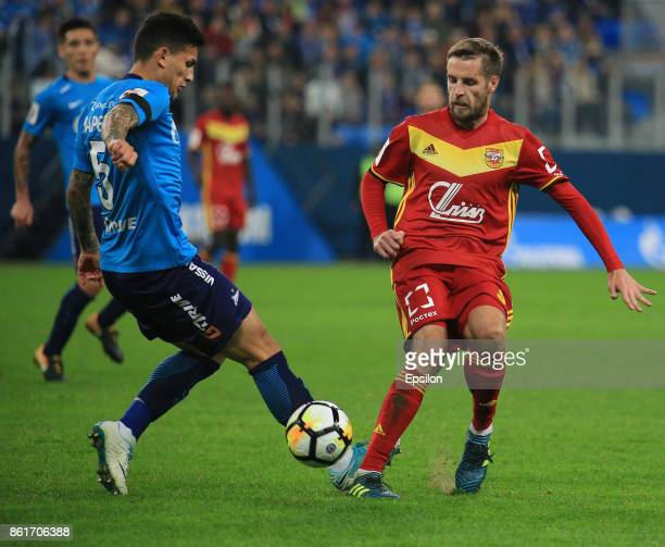 Emiliano Paredes of FC Zenit St Petersburg vies for the ball with Kirill Kombarov of FC Arsenal Tula during the during the Russian Premier League...