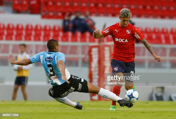Emiliano Rigoni of Independiente fights for the ball with Teodoro Paredes of Atletico Rafaela during a match between Independiente and Atletico de...