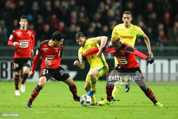 Emiliano Sala of Nantes and Benjamin Andre and Joris Gnagnon of Rennes during the French Ligue 1 match between Rennes and Nantes at Stade de la Route...