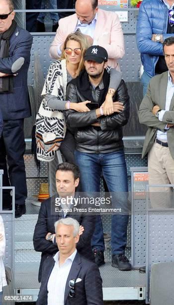 Emiliano Suarez and Carola Baleztena attend Mutua Madrid Open tennis at La Caja Magica on May 13 2017 in Madrid Spain