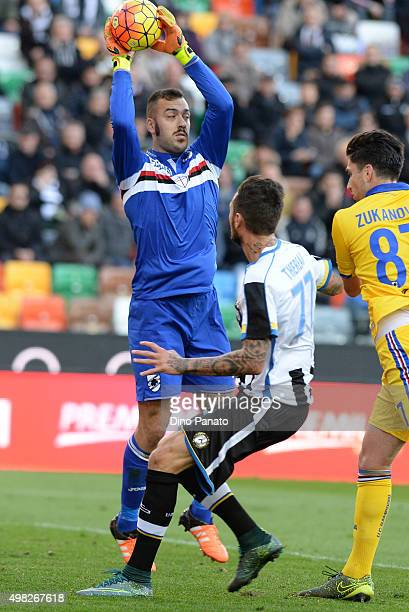 Emiliano Viviano goalkeeper of UC Samdoria safes the ball with Cyril Thereau of Udinese Calcio during the Serie A match between Udinese Calcio and UC...