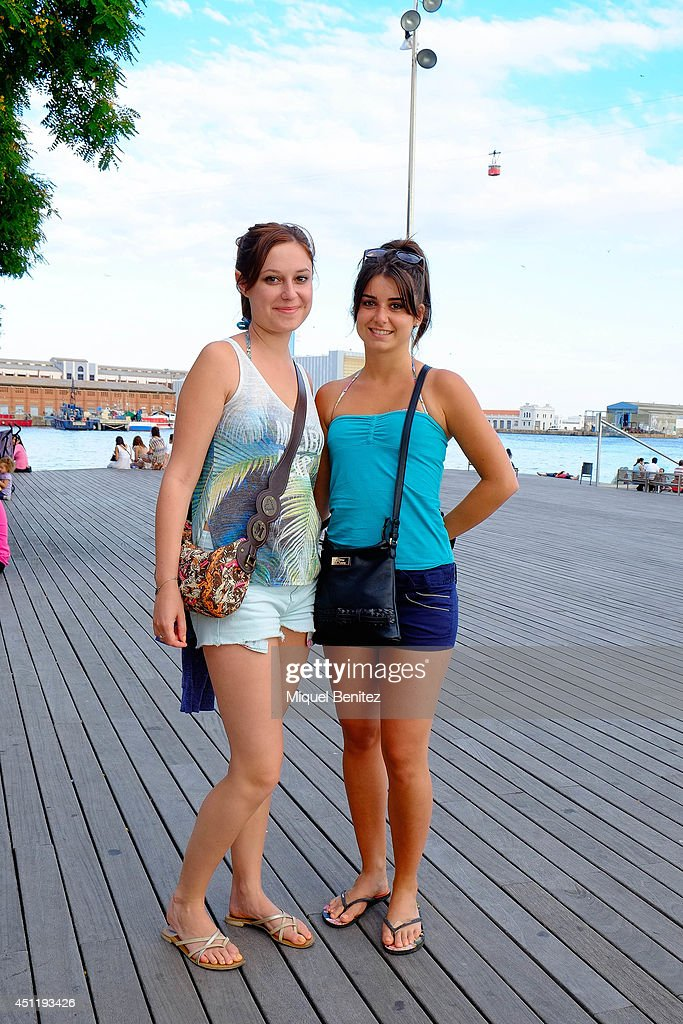 Emilie and Lorien from France. Emilie seen wearing a Mango's top, a Mango's shorts, Etam's swimsuit and a Morgan's handbag. Lorien seen wearing a Pinkie's top, a Calcedonia's shorts, a Rip Curl's swimsuit and Dallery's shoes on June 25, 2014 in Barcelona, Spain.