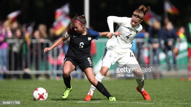 Emilie Bernhardt of Germany and Talia Dellaperuta of United States compete for the ball during the Girls U16 international friendly match between...
