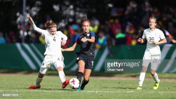 Emilie Bernhardt of Germany and Trinity Rodman of United States compete for the ball during the Girls U16 international friendly match between...