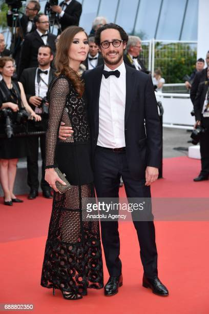 Emilie Broussouloux and Thomas Hollande arrive for the film L'Amant Double in competition at the 70th annual Cannes Film Festival in Cannes France on...