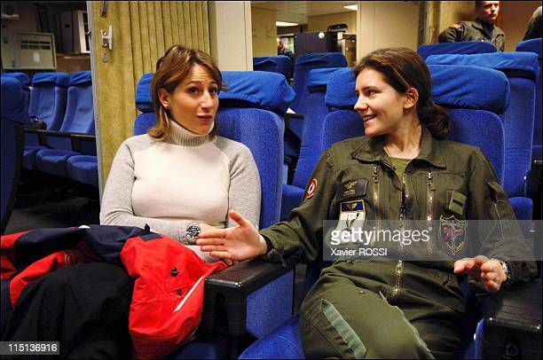 Emilie Denis the first woman fighter pilot of the French Navy in Toulon France on January 18 2006 With Maud Fontenoy in the preflight squadron room