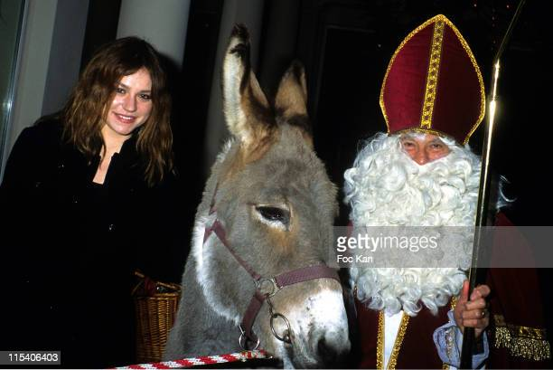 Emilie Dequenne and Santa Claus during Bristol Hotel's Santa Claus Tea Party November 30 2005 at Bristol Hotel in Paris France