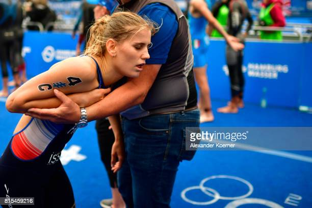 Emilie Morier of France arrives at the finish line during the Elite Mixed Relay at Hamburg Wasser ITU World Triathlon Championships 2017 on July 16...