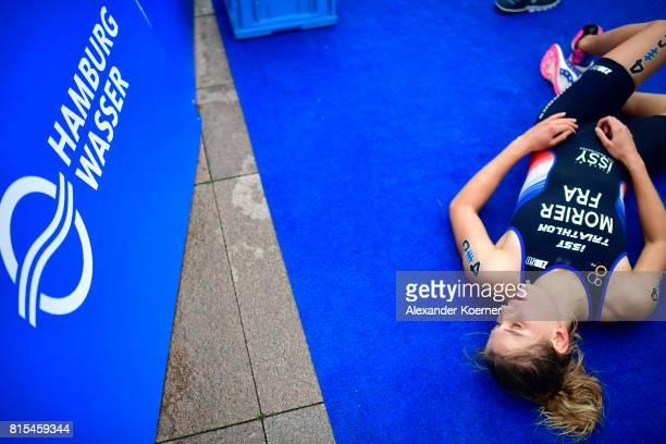 Emilie Morier of France arrives lies the finish line during the Elite Mixed Relay at Hamburg Wasser ITU World Triathlon Championships 2017 on July 16...