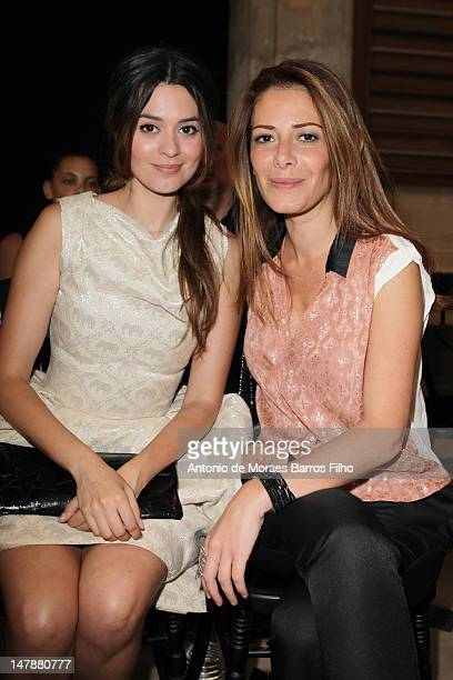Emilie Simon and Elsa Fayer attend the Didit Hediprasetyo HauteCouture Show as part of Paris Fashion Week Fall / Winter 2013 at L'Oratoire Du Louvre...