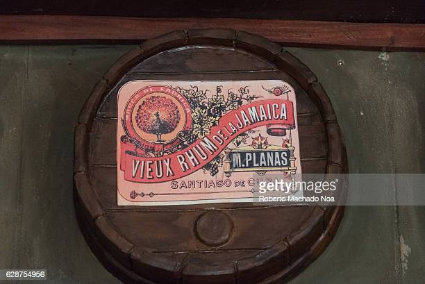 Emilio Bacardi House of Rum brand name labels in oak wooden barrels of the drink M Planas The place is a tourist attraction in the tropical city