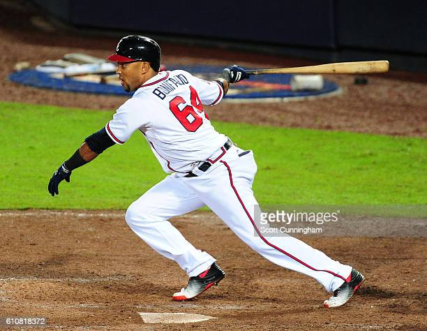 Emilio Bonafacio of the Atlanta Braves knocks in the eventual game winning run with an eighth inning single against the Philadelphia Phillies at...