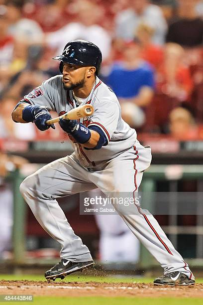 Emilio Bonifacio of the Atlanta Braves bats against the Cincinnati Reds at Great American Ball Park on August 23 2014 in Cincinnati Ohio