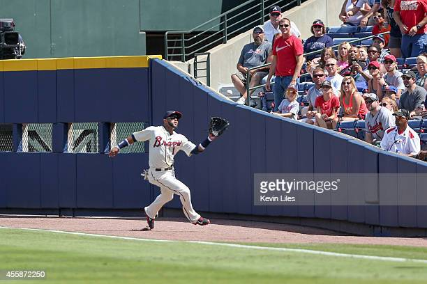 Emilio Bonifacio of the Atlanta Braves makes a catch in right field against the New York Mets during the first inning at Turner Field on September 21...