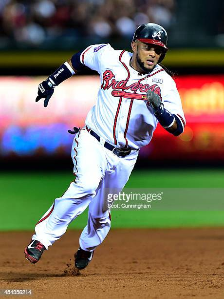 Emilio Bonifacio of the Atlanta Braves rounds the bases to score a seventh inning run against the Miami Marlins at Turner Field on August 29 2014 in...