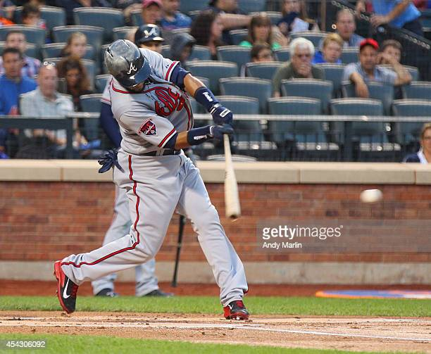 Emilio Bonifacio of the Atlanta Braves singles in the first inning against the New York Mets during the game at Citi Field on August 28 2014 in the...