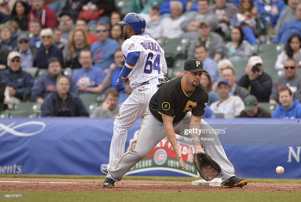 Emilio Bonifacio of the Chicago Cubs beats the throw for a single as first baseman Gaby Sanchez of the Pittsburgh Pirates catches the ball during the...